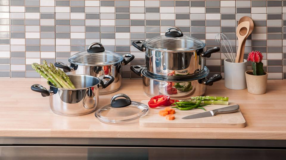steel cookware set with modern kitchen.