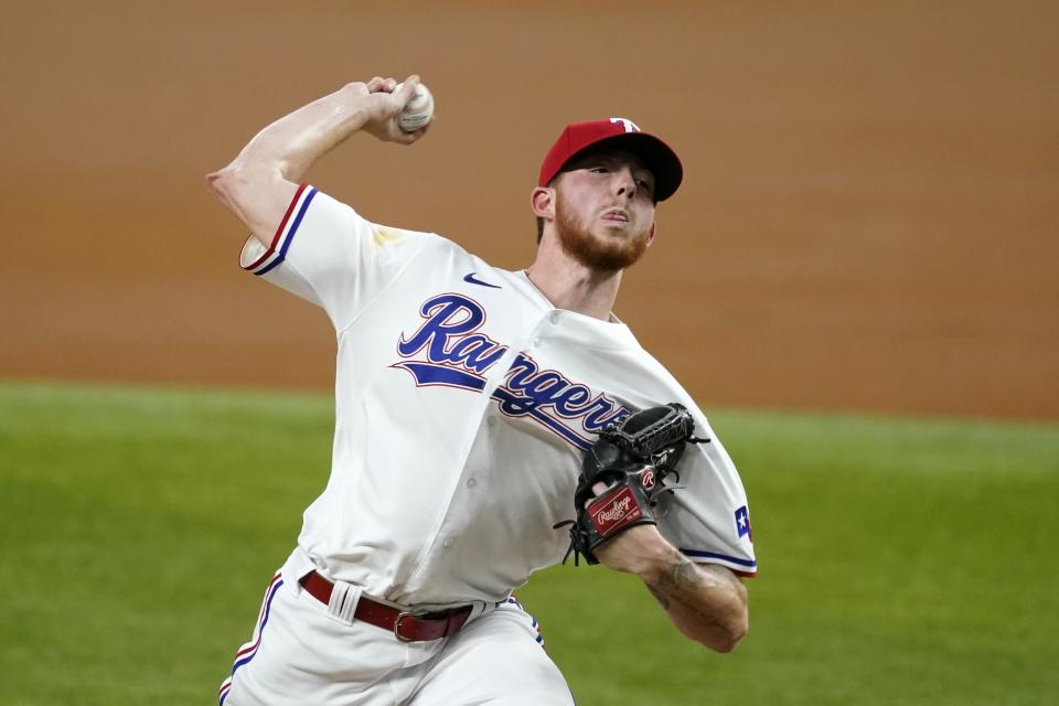 Texas Rangers starting pitcher A.J. Alexy throws to the Los Angeles Angels in the first inning of a baseball game in Arlington, Texas, Tuesday, Sept. 28, 2021. (AP Photo/Tony Gutierrez)