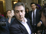 FILE - In this May 6, 2019, file photo, Michael Cohen, former attorney to President Donald Trump, leaves his apartment building before beginning his prison term in New York. Cohen pleaded guilty to orchestrating payments made during President Trump's 2016 campaign to porn actress Stormy Daniels and model Karen McDougal, to prevent them from publicly alleging they had extramarital affairs with him. (AP Photo/Kevin Hagen, File)