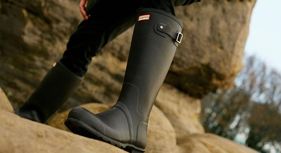 Wellington boots are a fail-safe footwear choice when braving the elements outdoors, especially Hunters' sell-out wellies, which are now back in stock. (Getty Images)
