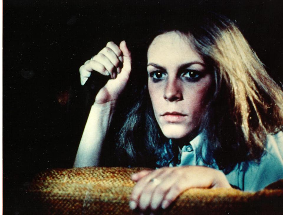 """Jamie Lee Curtis wields a knife in the 1978 horror film classic """"Halloween,"""" directed by John Carpenter."""