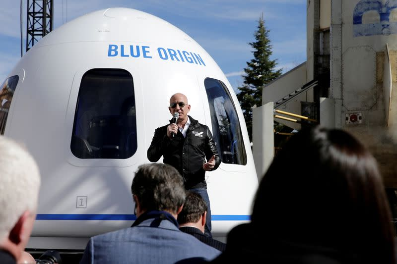 FILE PHOTO: Amazon and Blue Origin founder Jeff Bezos addresses the media about the New Shepard rocket booster and Crew Capsule mockup at the 33rd Space Symposium in Colorado Springs