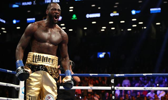 Deontay Wilder celebrates after knocking down Bermane Stiverne during the first round of Saturday's fight. (Getty)