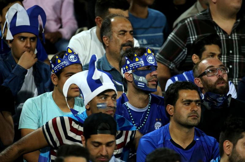 Esteghlal supporters attend the AFC Champions League group C football match between Iran's Esteghlal and Qatar's Al Duhail at the Azadi Stadium in Tehran on May 6, 2019. (Photo by ATTA KENARE / AFP) (Photo credit should read ATTA KENARE/AFP/Getty Images)