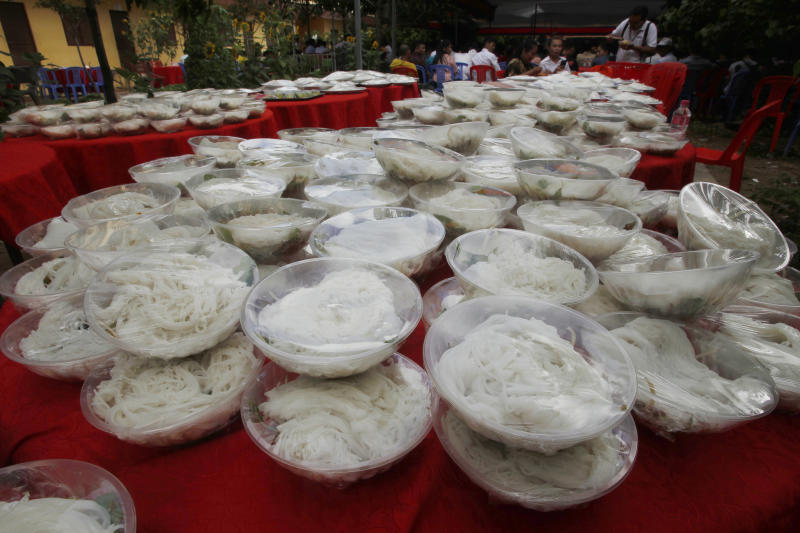 Bowls of noodle are placed at a Buddhist pagoda for garment workers at outside Phnom Penh, Cambodia, Sunday, June 9, 2019. The bitter decadeslong rivalry between Hun Sen, Cambodia's strongman leader, and Sam Rainsy, the self-exiled chief political rival and critic, has sometimes played out in deadly violence. But on Sunday, soup rather than blood was likely to be spilled. (AP Photo/Heng Sinith)