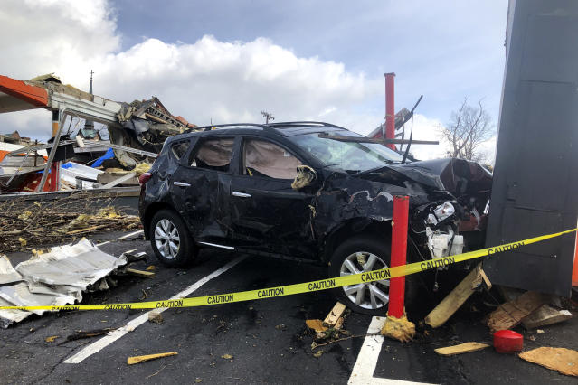 A vehicle is seen damaged after a powerful storm, in Nashville, Tenn. on Tuesday, March 3, 2020. Tornadoes ripped across Tennessee early Tuesday, shredding at least 40 buildings and killing many people. One of the twisters caused severe damage across downtown Nashville and leaving hundreds of people homeless. (AP Photo/Travis Loller)