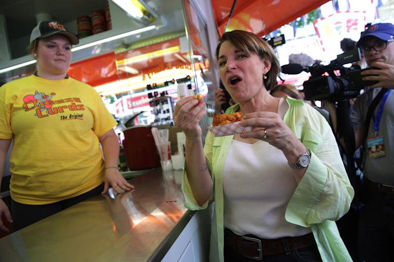 Sen. Amy Klobuchar (D-Minn.) eats cheese curds at the state fair on Aug. 10.