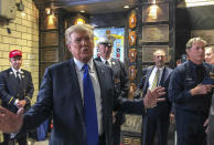 Former President Donald Trump visits the Engine Co. 8 firehouse where he praised first responders' bravery while criticizing President Joe Biden over the pullout from Afghanistan, Saturday Sept. 11, 2021, in New York. (AP Photo/Jill Colvin)