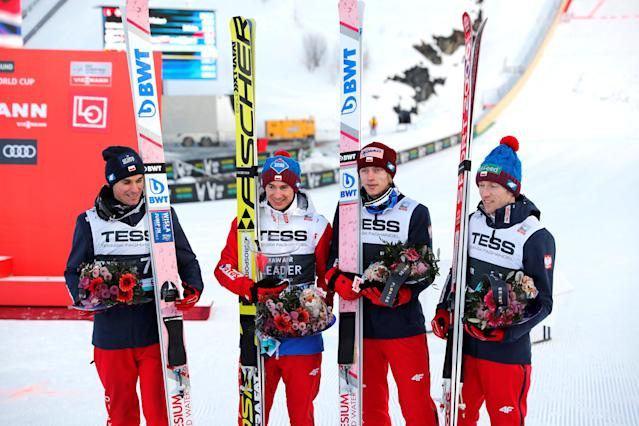 Ski Jumping - FIS World Cup - Men's Team - Vikersund, Norway - March 17, 2018. Piotr Zyla, Kamil Stoch, Dawid Kubacki and Stefan Hula of Poland celebrate their second place. NTB Scanpix/Terje Bendiksby via REUTERS ATTENTION EDITORS - THIS IMAGE WAS PROVIDED BY A THIRD PARTY. NORWAY OUT. NO COMMERCIAL OR EDITORIAL SALES IN NORWAY.