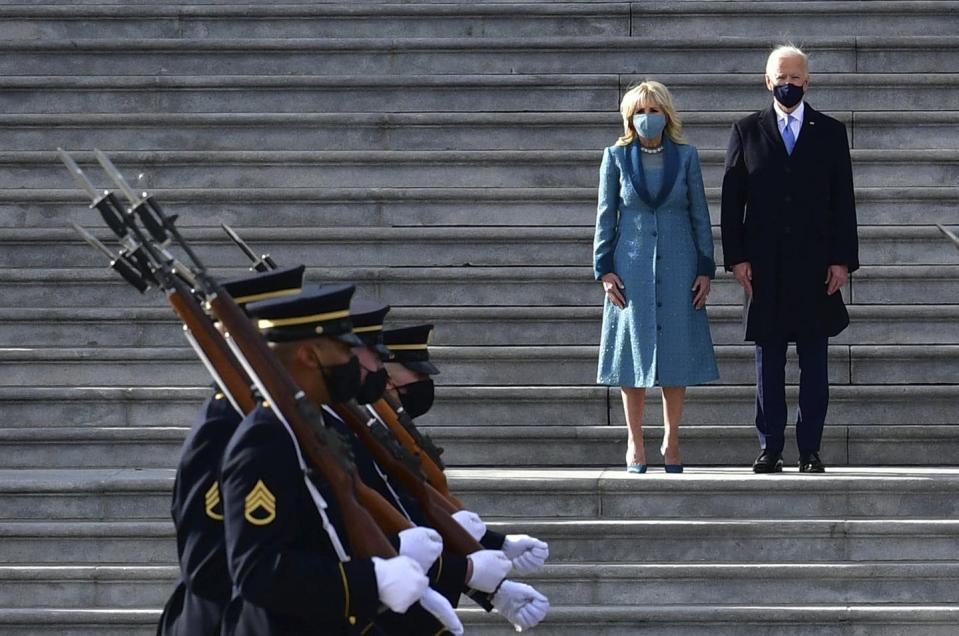"""<span class=""""caption"""">President Joe Biden and first lady Jill Biden review the troops from the east steps of the U.S. Capitol during the inauguration on Jan. 20, 2021, in Washington.</span> <span class=""""attribution""""><span class=""""source"""">(David Tulis/Pool Photo via AP)</span></span>"""