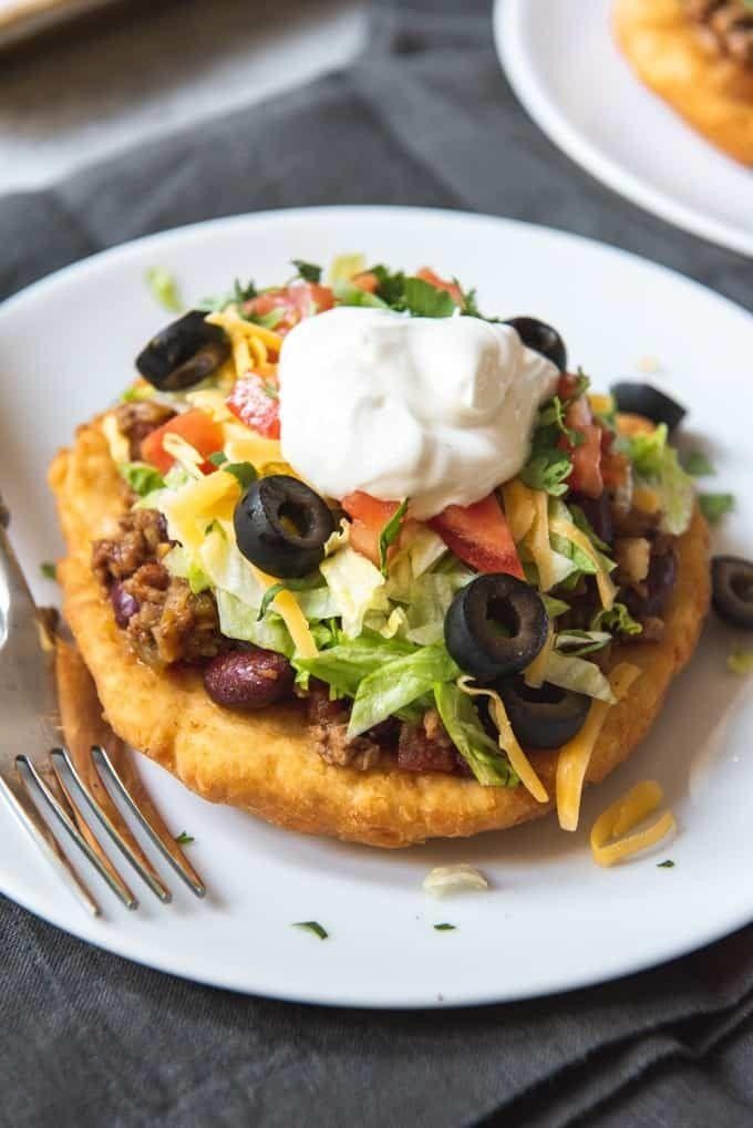 """<p><strong>Navajo Taco</strong></p><p>Not just any taco, but with unique fry bread, which is only found in a certain part of the country. Served at <a href=""""http://www.twinrockscafe.com/"""" rel=""""nofollow noopener"""" target=""""_blank"""" data-ylk=""""slk:Twin Rocks Cafe"""" class=""""link rapid-noclick-resp"""">Twin Rocks Cafe</a>, puffy and crispy rounds compliment the taco fillings -- ground beef, shredded lettuce and cheddar cheese. </p>"""