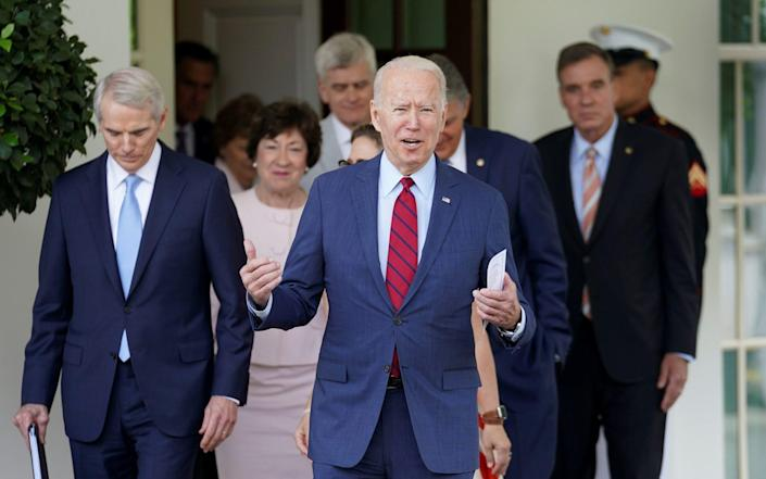 Joe Biden made a surprise appearance in front of the cameras with a group of Republicans and Democrat senators - REUTERS
