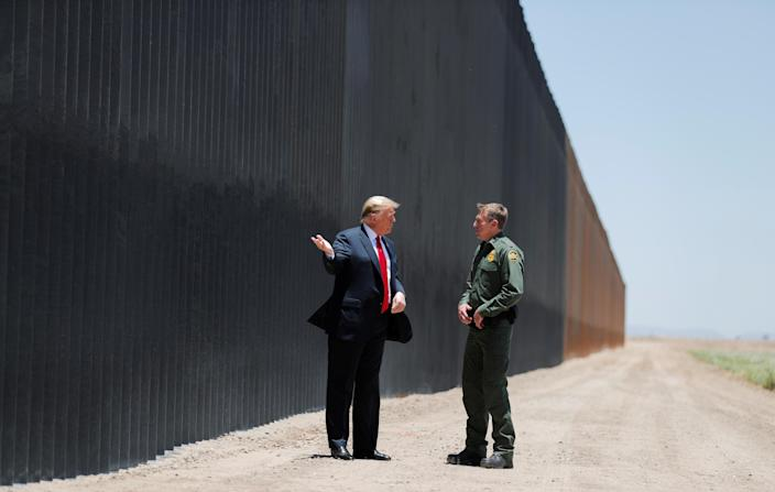 U.S. President Donald Trump talks with U.S. Border Patrol Chief Rodney Scott as he tours a section of the U.S.-Mexico border wall in San Luis, Arizona, U.S., June 23, 2020. REUTERS/Carlos Barria TPX IMAGES OF THE DAY