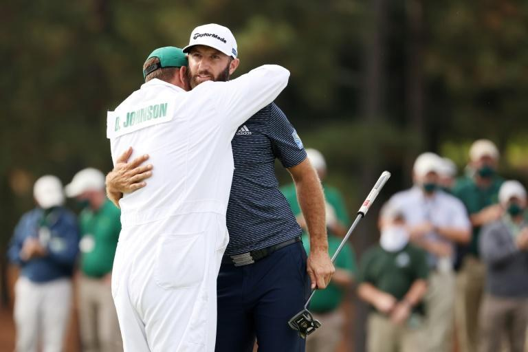Masters winner Dustin Johnson, right, celebrates the victory by hugging his brother, and caddie, Austin Johnson