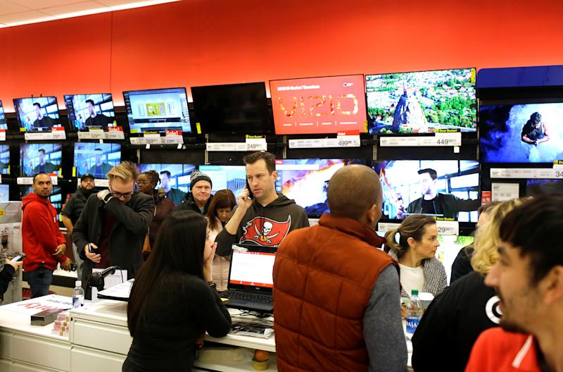 Customers shop during Black Friday sales at a Target store in Chicago, Illinois, U.S. November 29, 2019. REUTERS/Joshua Lott