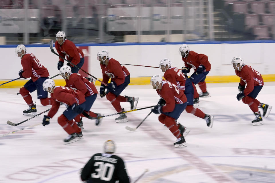 Florida Panthers defenseman Aaron Ekblad, center, skates with his teammates during NHL hockey training camp, Wednesday, Jan. 6, 2021, in Sunrise, Fla. (AP Photo/Lynne Sladky)