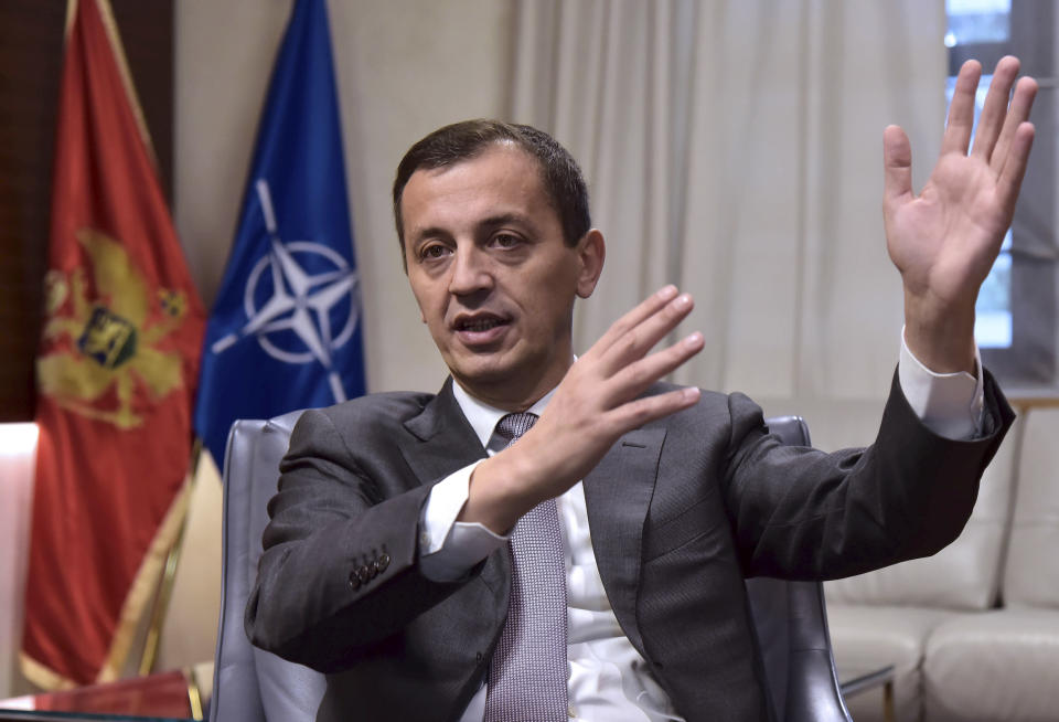 In this photo taken Monday, Nov. 11, 2019, Montenegrin Defense Minister Predrag Boskovic speaks and gestures during an interview with The Associated Press in Montenegro's capital Podgorica. Deployed inside the sprawling communist-era army command headquarters in Montenegro's capital, a group of elite U.S. military cyber experts are plotting strategy in a fight against potential Russian and other cyberattacks ahead of the 2020 American and Montenegrin elections. (AP Photo/Risto Bozovic)