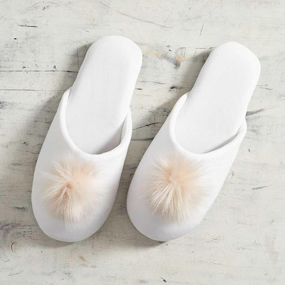 <p>There's nothing better than opening up a pair of cozy slippers on Christmas morning. Get a pair of these oh-so-soft velvet slides for your family to keep them warm and comfortable while chilling at home—their feet deserve it.</p>