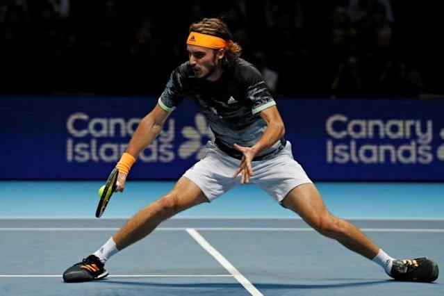 Stefanos Tsitsipas in action against Daniil Medvedev during their round-robin match on day two of the ATP Finals (AFP Photo/Adrian DENNIS)