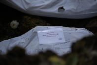 A body bag containing the remains of an unknown migrant who died trying to cross the Darien gap is buried at the Guayabillo cemetery in Agua Fria, Panama, Thursday, Sept. 30, 2021. (AP Photo/Arnulfo Franco)