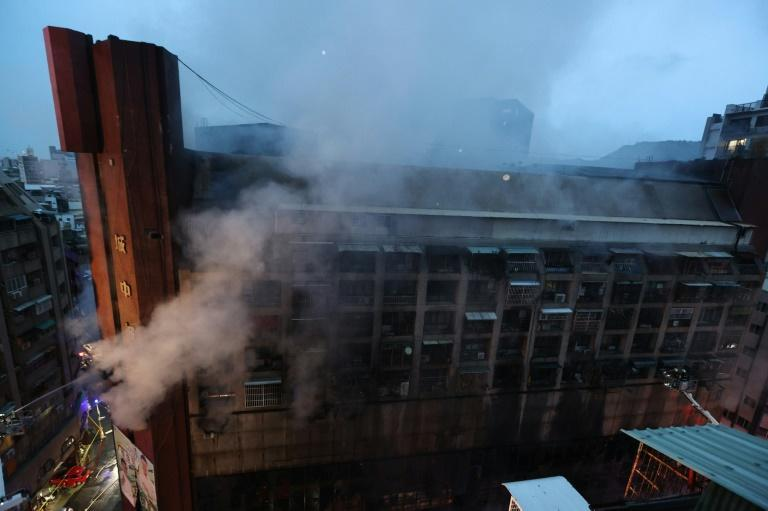 The blaze broke out in the 13-storey, mixed-use building in the small hours of Thursday morning (AFP/Johnson Liu)