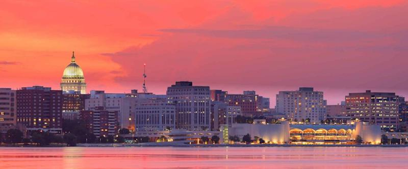 Skyline of Madison of Wisconsin at sunset viewing from Olin Turville Park. Photo showing the state capital and lake Monona with reflections, Madison, Wisconsin, USA.