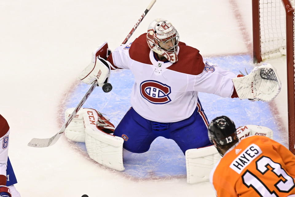 Montreal Canadiens goaltender Carey Price (31) makes save as Philadelphia Flyers centre Kevin Hayes (13) looks on during the second period of an NHL Eastern Conference Stanley Cup hockey playoff game in Toronto, Friday, Aug. 14, 2020. (Frank Gunn/The Canadian Press via AP)