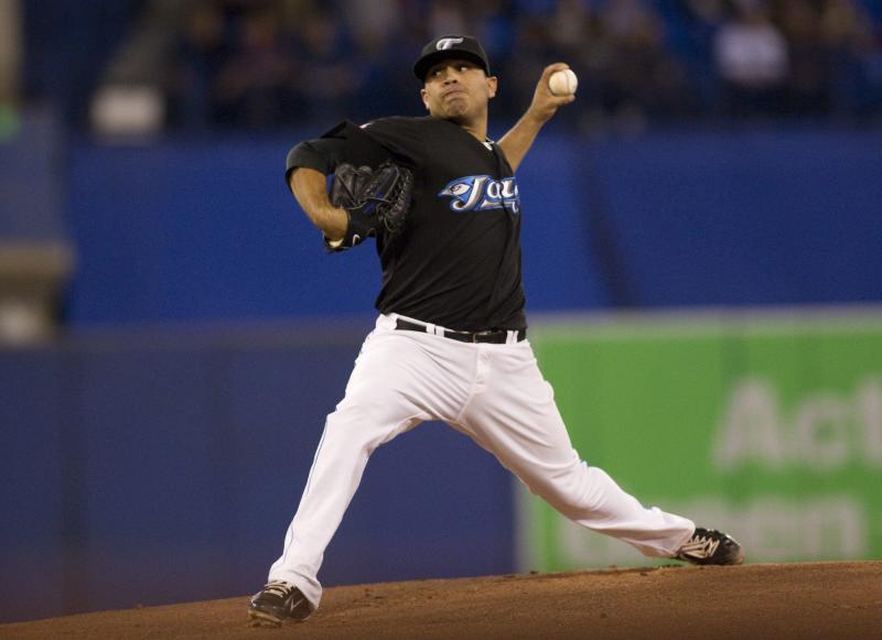 Toronto Blue Jays starting pitcher Ricky Romero throws against the Los Angeles Angels during the first inning of a baseball game in Toronto on Monday Sept. 19, 2011.  (AP Photo/The Canadian Press, Chris Young)