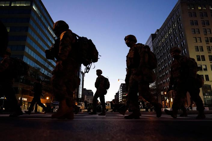 National Guards patrol the streets of the nation's capital on Tuesday night ahead of President-elect Joe Biden's inauguration ceremony.