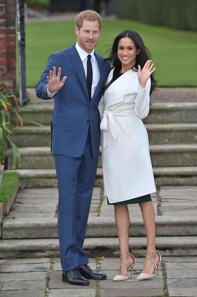 "<p>They have the wave down! Harry described himself as ""thrilled, over the moon"" about the engagement. As for when he realized she's the one, he said, ""The very first time we met."" That meeting took place in July 2016. They were reportedly introduced in London through a mutual friend, Markus Anderson, and made their first public appearance in September at the Invictus Games opening ceremony. (Photo: Chris Jackson/Getty Images) </p>"
