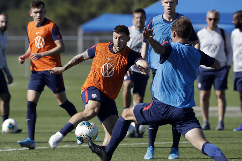 Paul Arriola, center, a forward on the U.S. Men's National Soccer team, kicks the ball during a scrimmage Wednesday, Jan. 8, 2020, in Bradenton, Fla. The team moved its training camp from Qatar to Florida in the wake of Iran's top military commander being killed during a U.S. airstrike in the Middle East. (AP Photo/Chris O'Meara)