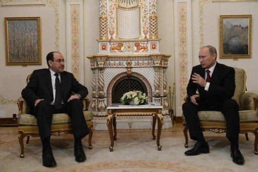 "Iraqi Prime Minister Nuri al-Maliki (left) meets Russia's President Vladimir Putin at the Novo-Ogaryovo residence outside Moscow earlier this month. ""When Maliki returned from his trip to Russia, he had some suspicions of corruption, so he decided to review the whole deal... There is an investigation going on, on this,"" says Maliki's spokesman Ali Mussawi"