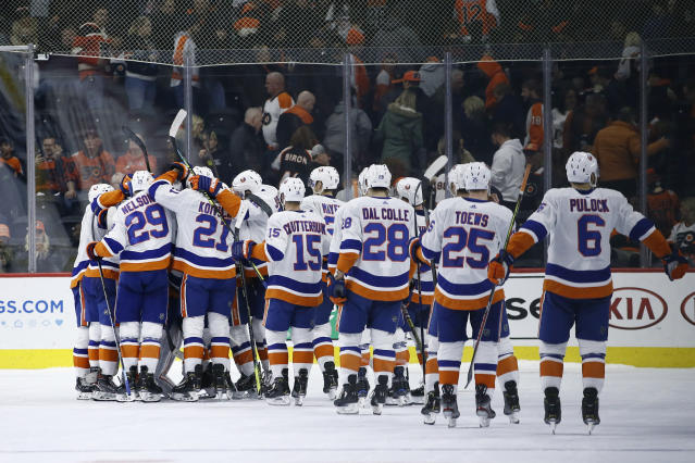 New York Islanders celebrate after winning an NHL hockey game against the Philadelphia Flyers, Saturday, Nov. 16, 2019, in Philadelphia. New York won 4-3 in a shootout. (AP Photo/Matt Slocum)