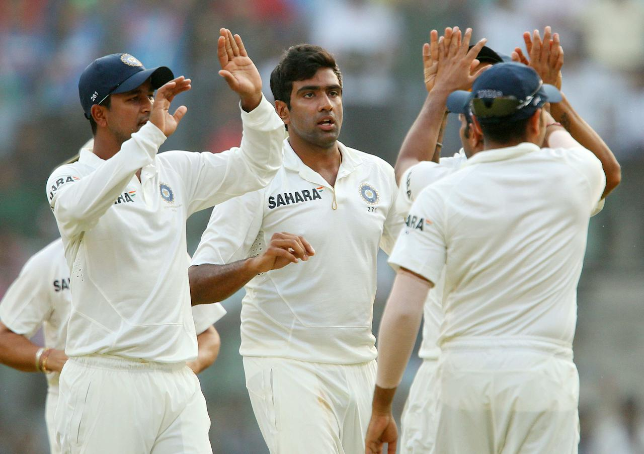 Ravichandran Ashwin of India celebrates the wicket of Kieran Powell of West Indies  during day two of the second Star Sports test match between India and The West Indies held at The Wankhede Stadium in Mumbai, India on the 15th November 2013  This test match is the 200th test match for Sachin Tendulkar and his last for India.  After a career spanning more than 24yrs Sachin is retiring from cricket and this test match is his last appearance on the field of play.   Photo by: Ron Gaunt - BCCI - SPORTZPICS  Use of this image is subject to the terms and conditions as outlined by the BCCI. These terms can be found by following this link:  https://ec.yimg.com/ec?url=http%3a%2f%2fsportzpics.photoshelter.com%2fgallery%2fBCCI-Image-Terms%2fG0000ahUVIIEBQ84%2fC0000whs75.ajndY&t=1501115870&sig=rnigKPGhgFw1.xgFmBvGeg--~C