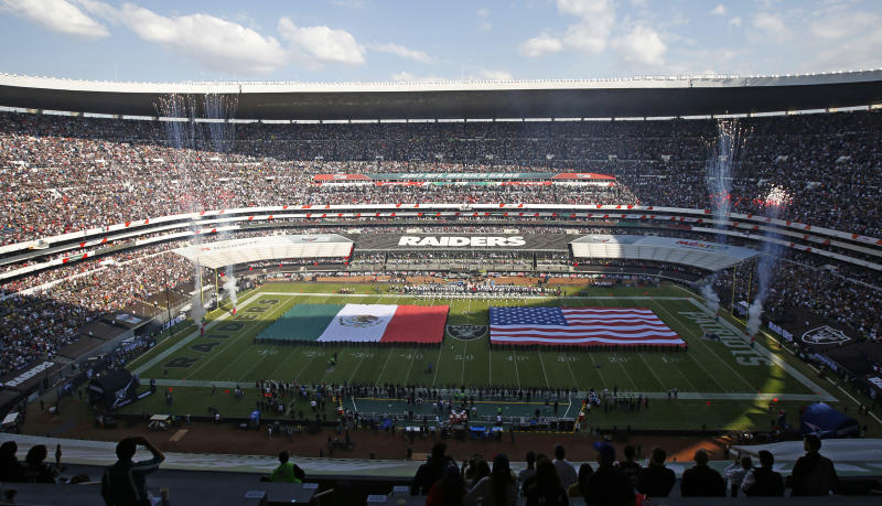 The U.S. and Mexico flags are displayed at Azteca stadium prior to the start of an NFL football game between the Oakland Raiders and the New England Patriots, Sunday, Nov. 19, 2017, in Mexico City. (AP Photo/Dario Lopez-Mills)