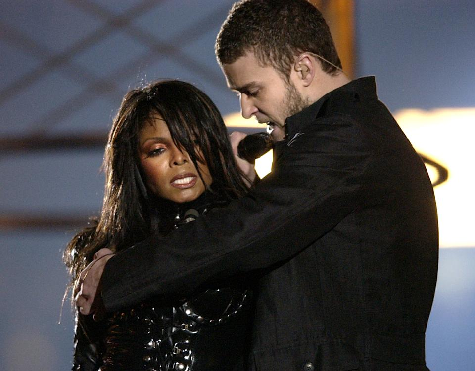 ** FILE ** In this Sunday Feb. 1, 2004 file picture, Justin Timberlake reaches across Janet Jackson during their performance just before he pulled off the covering to her right breast, which was partially obscured by a sun-shaped, metal nipple decoration during the half time performance at Super Bowl XXXVIII in Houston. The Federal Communications Commission has asked the U.S. Supreme Court to review the indecency case over Janet Jackson's breast-baring performance at the 2004 Super Bowl. (AP Photo/David Phillip, File)