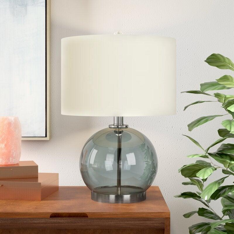 """<br><br><strong>Joss & Main</strong> Trevon Table Lamp, $, available at <a href=""""https://go.skimresources.com/?id=30283X879131&url=https%3A%2F%2Ffave.co%2F2HQbUfl"""" rel=""""nofollow noopener"""" target=""""_blank"""" data-ylk=""""slk:Joss & Main"""" class=""""link rapid-noclick-resp"""">Joss & Main</a>"""