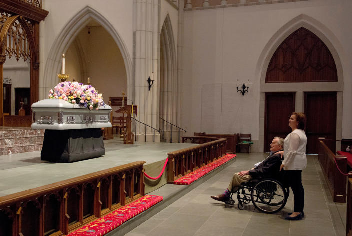 "<p>Former President George H. W. Bush looks at the casket of his wife, former first lady Barbara Bush, with his daughter Dorothy ""Doro"" Bush Koch at St. Martin's Episcopal Church Friday, April 20, 2018, in Houston. Barbara Bush died on April 17, 2018, at the age of 92. (Photo: Mark Burns/Office of George H.W. Bush via AP) </p>"