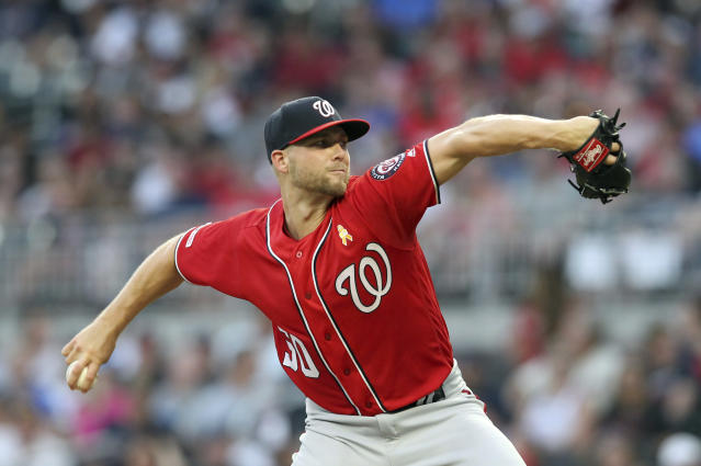 Washington Nationals starting pitcher Austin Voth throws to an Atlanta Braves batter during the first inning of a baseball game Saturday, Sept. 7, 2019, in Atlanta. (AP Photo/Tami Chappell)
