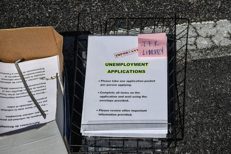 Unemployment forms are seen kept at a drive thru collection point outside John F. Kennedy Library in Hialeah, Florida, on April 8, 2020. (Photo by CHANDAN KHANNA / AFP) (Photo by CHANDAN KHANNA/AFP via Getty Images)