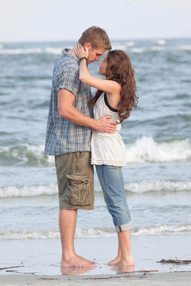 First kiss: Liam Hemsworth and Miley Cyrus met on set of The Last Song (Touchstone Pictures)