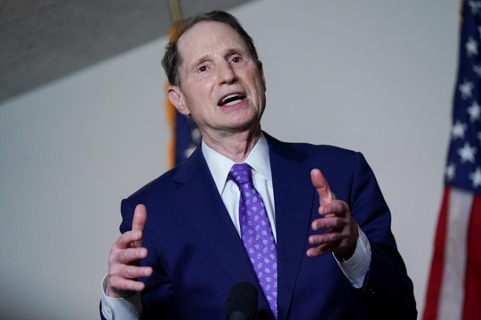 Sen. Ron Wyden (D-OR) speaks during a news conference after the first Democratic luncheon meeting since COVID-19 restrictions went into effect on Capitol Hill in Washington, U.S. April 13, 2021. REUTERS/Erin Scott