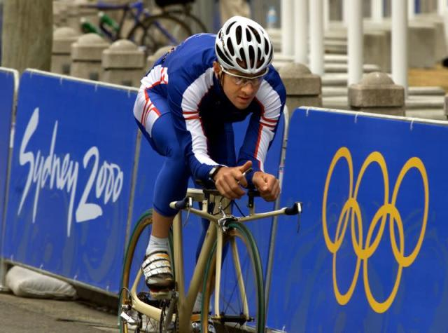 BRITISH CYCLIST CHRIS BOARDMAN TRAINS ON THE OLYMPIC ROAD RACE COURSE.