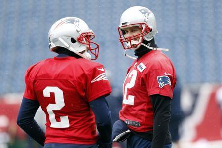 Jan 17, 2018; Foxborough, Massachussetts, USA; New England Patriots quarterback Tom Brady (12) talks with quarterback Brian Hoyer (2) during practice before the AFC Press Conference at Gillette Stadium. Mandatory Credit: Greg M. Cooper-USA TODAY Sports
