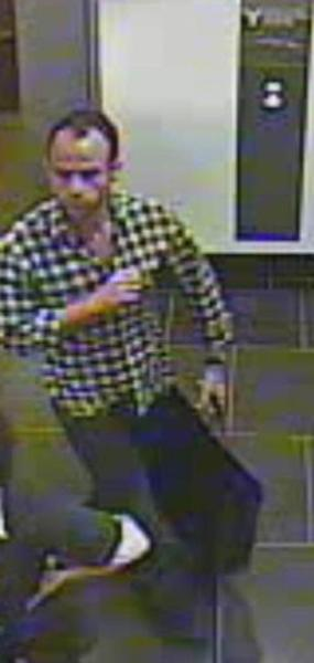"""This image provided by the New York Police Department shows a surveillance camera image of a man suspected of stealing a $150,000 Salvador Dali painting from a Manhattan art gallery Thursday June 21, 2012. Police say the man walked into the Venus Over Manhattan art gallery on Madison Avenue posing as a customer and removed the watercolor and ink painting from the wall, put it in a bag, and fled. The 1949 painting, called """"Cartel des Don Juan Tenorio,"""" was part of the gallery's inaugural exhibition. (AP Photo/New York Police Department)"""