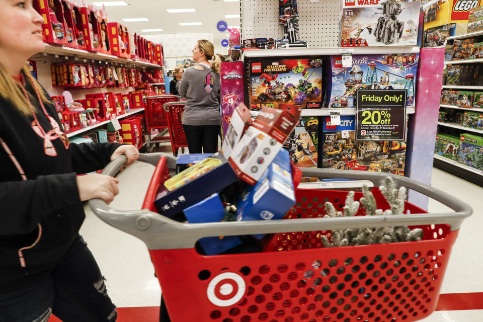 In this Nov. 23, 2018, file photo shoppers browse the aisles during a Black Friday sale at a Target store in Newport, Ky. (AP Photo/John Minchillo, File)