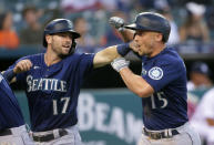 Seattle Mariners' Kyle Seager (15) celebrates with Mitch Haniger (17) after hitting a three-run home run against the Detroit Tigers during the sixth inning of a baseball game Wednesday, June 9, 2021, in Detroit. (AP Photo/Duane Burleson)