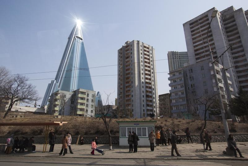 FILE - In this April 1, 2012 file photo, the sun is reflected from the top of the 105-story Ryugyong Hotel, which remains under construction, in Pyongyang, North Korea. International hotel operator Kempinski AG said Thursday, Nov. 1, 2012 it will manage the pyramid-shaped hotel that is expected to open next year with shops, offices, ball rooms and restaurants and 150 rooms. (AP Photo/David Guttenfelder, File)