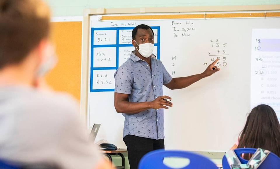 """Ewan Lilly, a fifth grade teacher at Eno Valley Elementary School in Durham, N.C., conducts a math lesson during the """"Camp Eno Valley"""" summer learning program on Monday, June 21, 2021."""