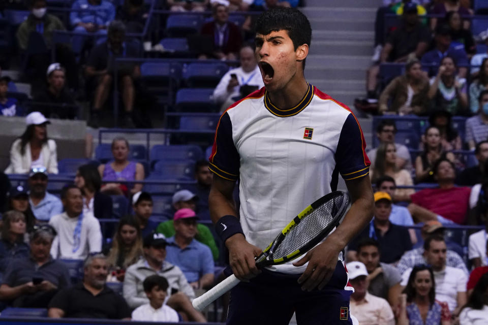 Carlos Alcaraz, of Spain, reacts after winning a point against Stefanos Tsitsipas, of Greece, during the third round of the US Open tennis championships, Friday, Sept. 3, 2021, in New York. (AP Photo/Seth Wenig)
